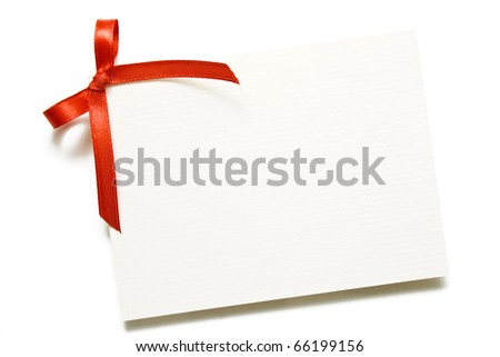 Blank gift tag with red bow isolated on white with soft shadow.