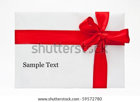 Blank gift with a bow of red satin ribbon