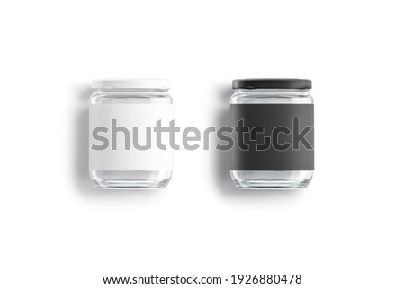 Blank glass jar with black and white label mockup lying, 3d rendering. Empty conservation transparent tin mock up, isolated, top view. Clear screw bank for canned food template. Foto stock ©