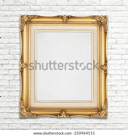 Blank Gold Vintage photo frame on white brick wall, Template for adding photo.