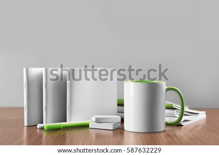 Photo of  Blank goods on wooden table and grey background