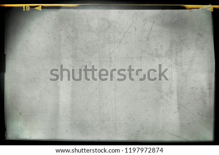 Blank grained and scratched film strip texture background #1197972874