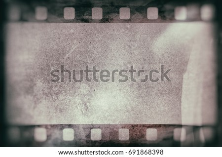 Blank grained and scratched film strip texture background #691868398