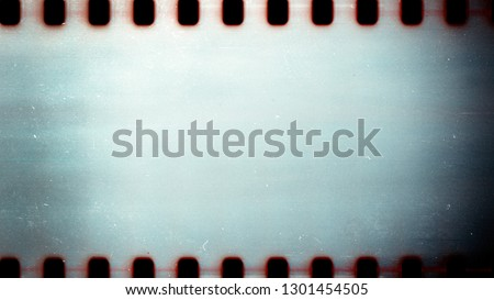 Blank grained film strip texture background with heavy grain dust and scratches