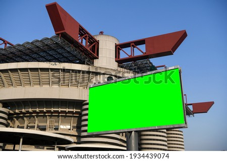 Blank green billboard outside stadium for new advertisement. Ideal for football, soccer, sport related ads. Milan, Italy Stock fotó ©