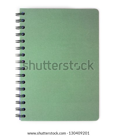 Blank green spiral coil notebook. Isolated on white.