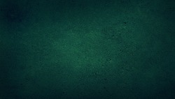 blank green texture surface background with dark corners. green grainy cement wall background with space for text.