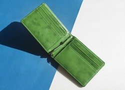 Blank green wallet isolated on blue and  white background . Open wallet .