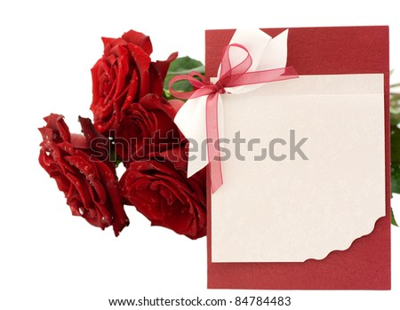 Blank greeting and a bouquet of red roses isolated