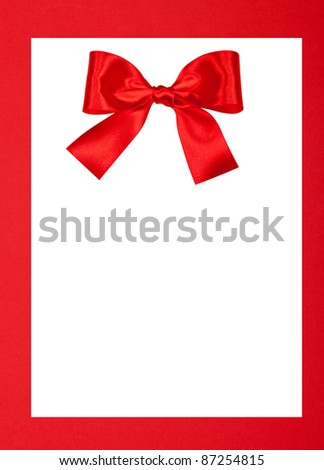 Blank Greeting card white isolated clipping path on red Christmas background with ribbon bow - stock photo