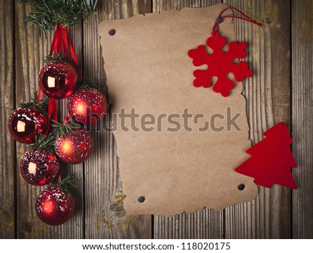 Blank grunge paper over wooden background and christmas ornament