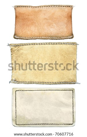 Blank grungy damaged leather jeans' labels, isolated on white background