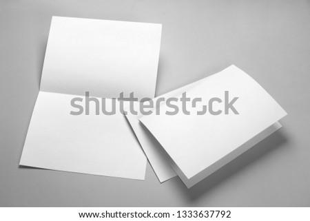 Blank half-folded booklet, postcard, flyer or brochure mockup template on gray background #1333637792