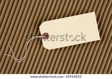 Blank hang tag with space for copy shot on corrugated cardboard