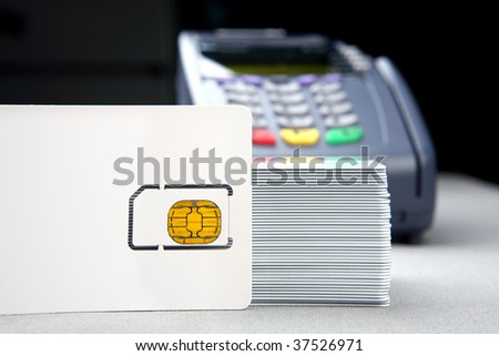 blank id card with chip and pos terminal in the background