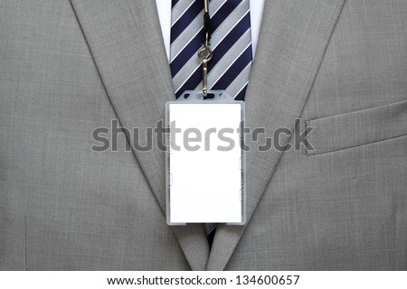 Blank identity name tag on a businessman suit on a lanyard