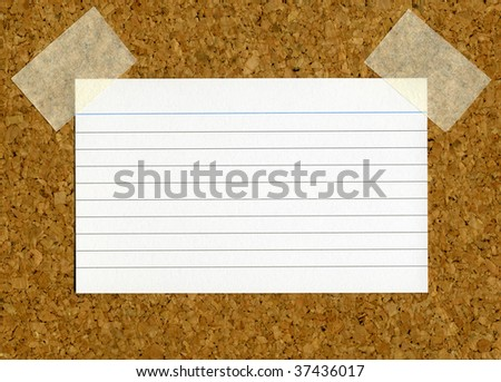 Blank index card stuck to a cork notice board.