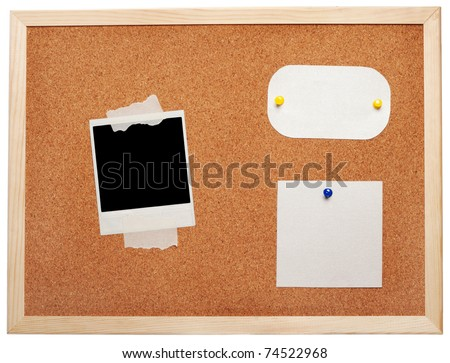 Blank instant photo and note papers on a cork board