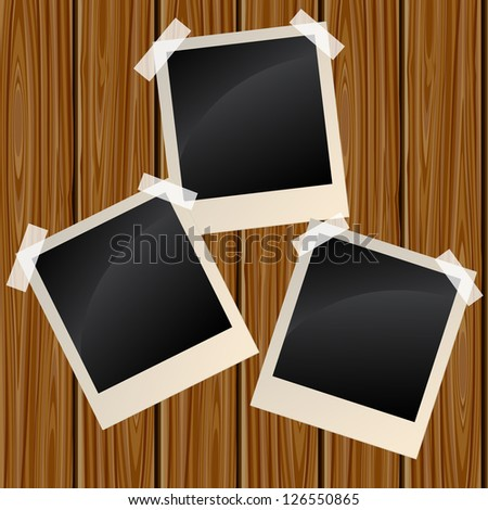 Blank instant photo frames on a wooden wall. Raster version. Vector is also available in my gallery