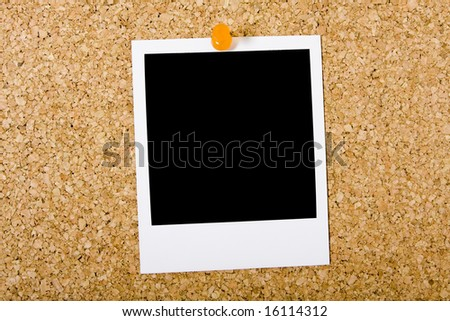 Blank instant photo picture pinned to a cork board - stock photo