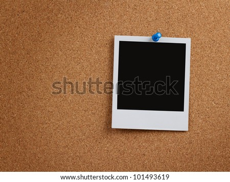 Blank instant photo pinned to a cork board with clipping path