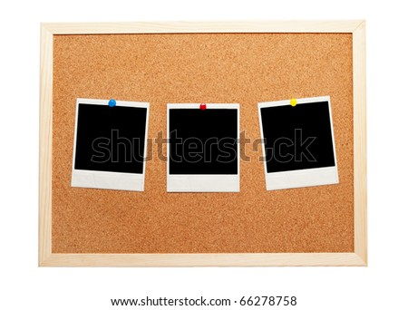 Blank instant photos on a corkboard