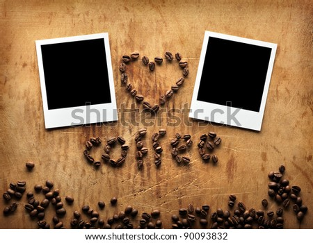 Blank instant photos with coffee beans in the shape of the heart on old dark grunge background. Invitation to visit.