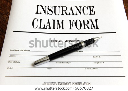 blank insurance claim form and pen #50570827
