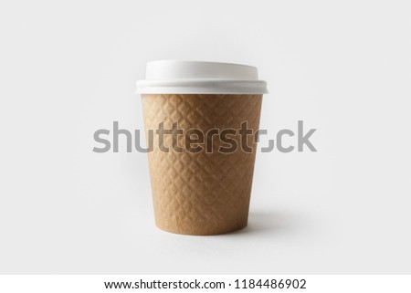 Blank kraft paper coffee cup with cap. Disposable cup #1184486902