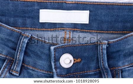 Blank label inside blue jeans