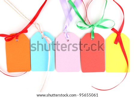 Blank labels with ribbon isolated on white
