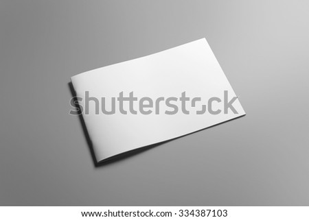 Blank landscape brochure magazine isolated on cardboard background, with clipping path, changeable background  #334387103