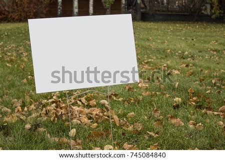 Blank lawn sign in park