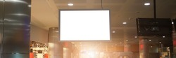 blank lcd information display whith empty white screen for mockup hanging on chain in city mall building ceiling front view