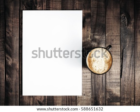 Blank letterhead and coffee cup on vintage wooden table background. Blank branding template. Blank stationery. Mockup for branding identity for placing your design. Top view.. Top view. 商業照片 ©