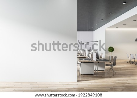 Blank light grey wall in sunny open space office with wooden floor and eco style furniture. Mockup. 3D rendering