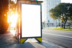 Blank lightbox on the bus stop. Horizontal. Sunlights effects