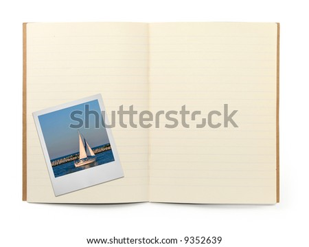 blank lined exercise book and photo frame, gentle shadow in front, photo inside is my property,