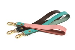 Blank loop pink green brown gray color leather key chain collection on isolated white background with clipping path. Pile set of metallic souvenir.