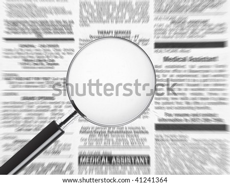 Blank magnifying glass over newspaper. Plenty of room to add text to display your message