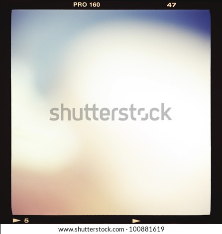 Blank medium format (6x6) color film frame with abstract filling containing light leak, kind of a background - stock photo
