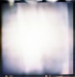 Blank medium format (6x6) color film frame with abstract filling with lot of light leaks, last exposure ending with tape, hard vintage film grain effect added; kind of a background