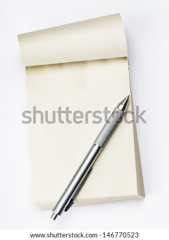 Blank memo pad with pen