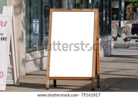 Blank menu board on sidewalk
