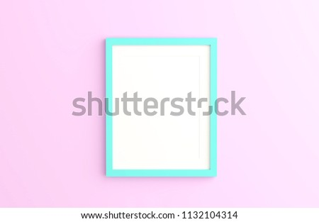 Blank mint color picture frame template for place image or text inside on pink wall.