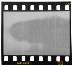 blank 35mm dia film strip on white with scratches and cool light reflection. old school photo placeholder.