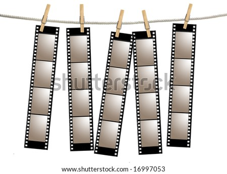 Blank 35mm Film Strip Negatives Hanging From A Rope By Clothespins