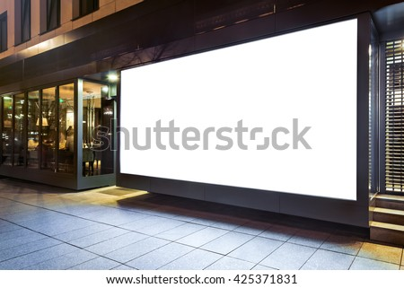 Blank mock up of store street showcase window in a city at night