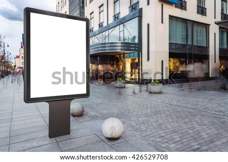 Blank mock up of vertical street ad billboard in busy city street