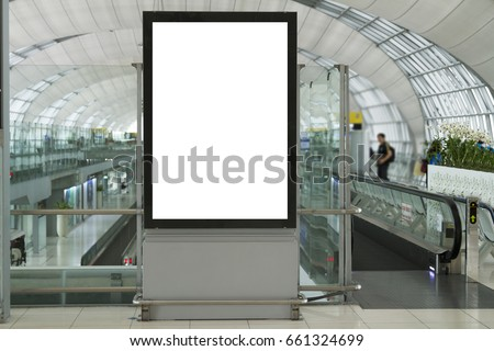 Blank mock up of vertical street poster billboard on Airport Background with plane passengers. #661324699